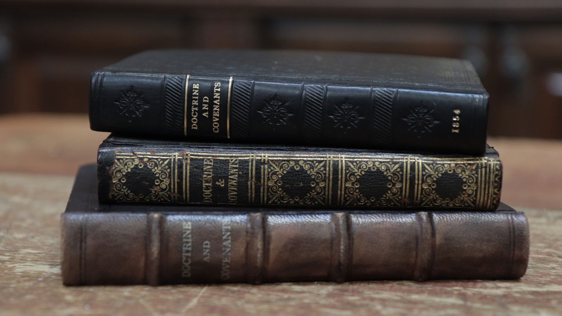 Antique editions of the Doctrine and Covenants, courtesy of Reid Moon. Photograph by Daniel Smith.